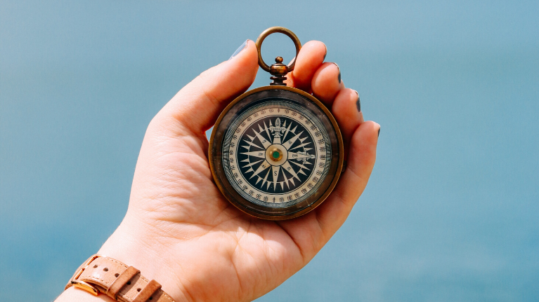 a compass, symbolizing the need to have a direction in achieving career goals